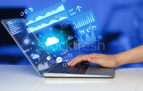 Hand using laptop with uploading reports and graphs concept Stock photo © ra2studio