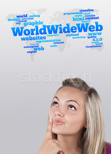 Young girl looking at internet type of icons Stock photo © ra2studio