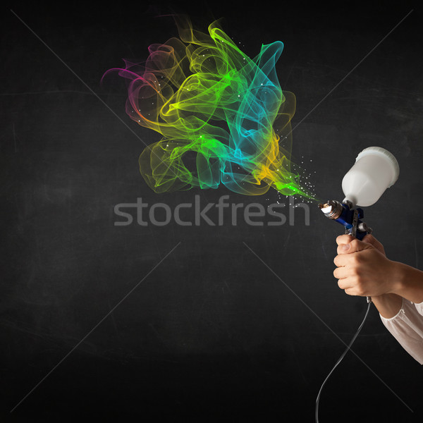 Painter working with airbrush and paints colorful paint Stock photo © ra2studio
