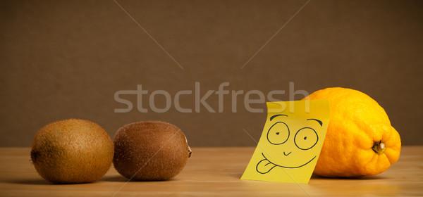 Lemon with post-it note sticking out tongue to kiwis Stock photo © ra2studio