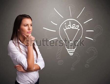 Jong meisje omhoog licht idee teken mooie Stockfoto © ra2studio