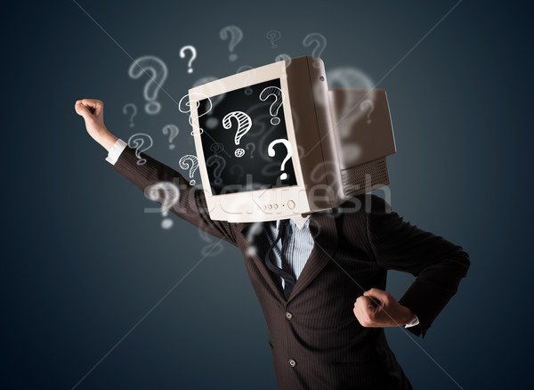 Businessman with a computer monitor head and question marks Stock photo © ra2studio