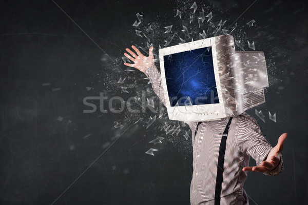 Computer monitor screen exploding on a young persons head  Stock photo © ra2studio