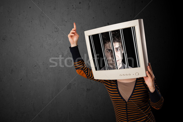 Business man with monitor on his head traped into a digital syst Stock photo © ra2studio