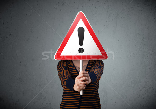 Young woman holding an exclamation road sign Stock photo © ra2studio