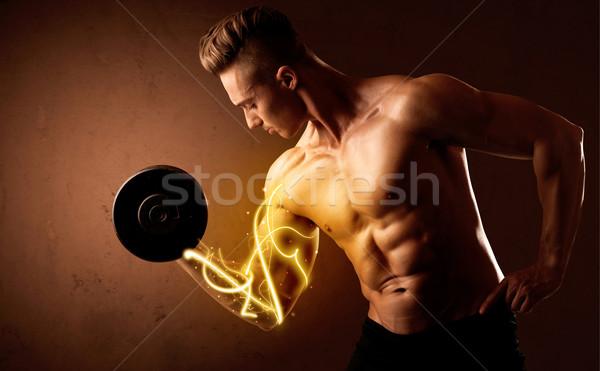 Corpo muscoloso builder peso energia luci Foto d'archivio © ra2studio