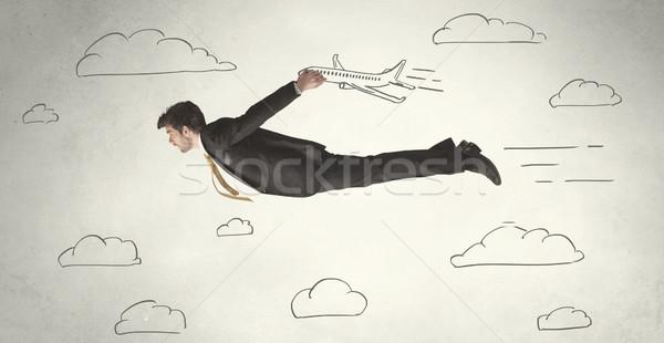 Derűs üzletember repülés kézzel rajzolt égbolt felhők Stock fotó © ra2studio
