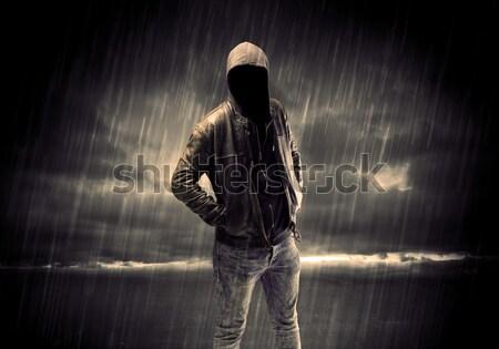 Anonymous terrorist in hoodie at night Stock photo © ra2studio