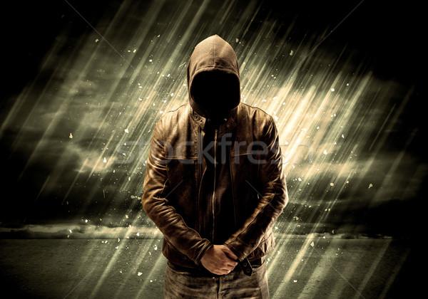 Dangerous criminal standing with cigarette Stock photo © ra2studio