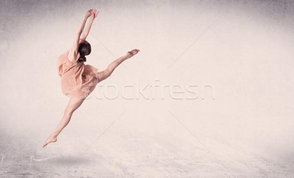 Modern ballet dancer performing art jump with empty background Stock photo © ra2studio
