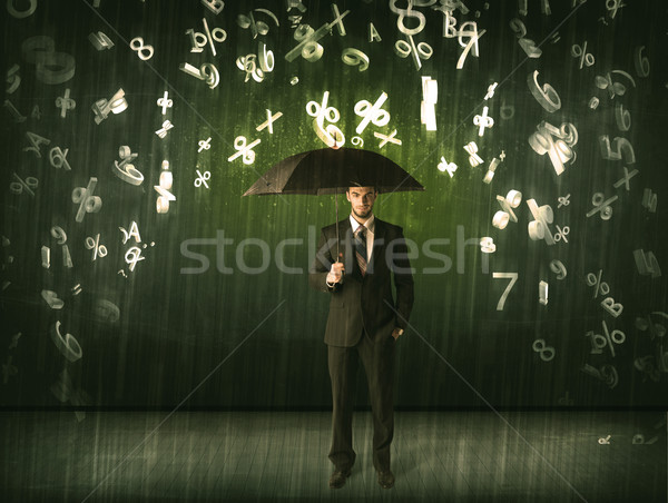 Businessman standing with umbrella and 3d numbers raining concep Stock photo © ra2studio