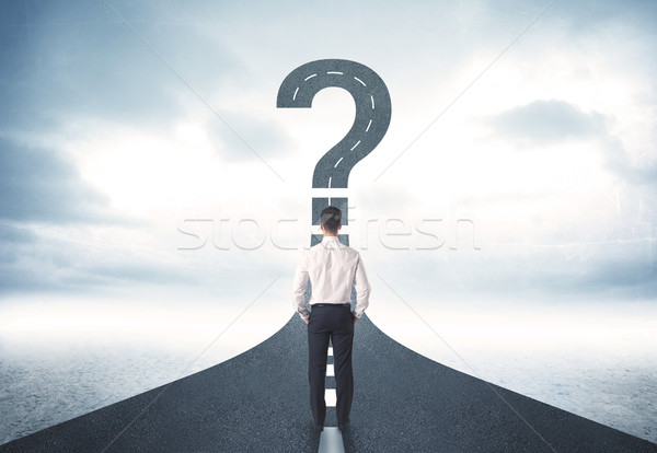 Business person lokking at road with question mark sign Stock photo © ra2studio