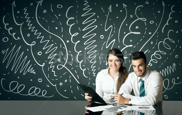 Business couple with curly lines and arrows Stock photo © ra2studio