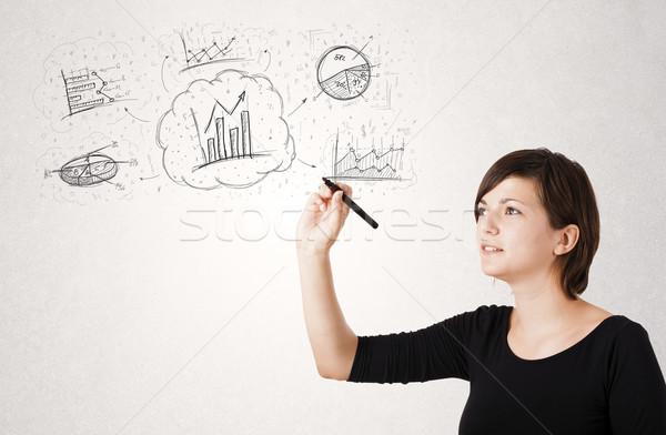 Young lady sketching financial chart icons and symbols Stock photo © ra2studio