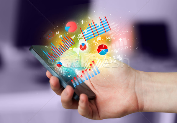 Człowiek biznesu smartphone wykres symbolika działalności Zdjęcia stock © ra2studio