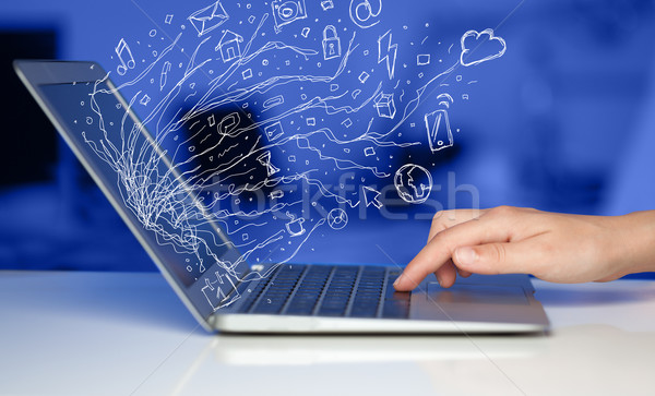 Man pressing notebook laptop computer with doodle icon cloud sym Stock photo © ra2studio