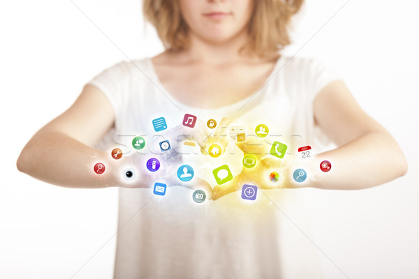 Hands creating a form with mobile app icons Stock photo © ra2studio