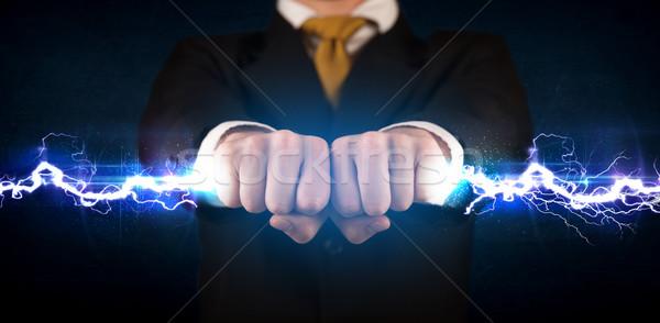 Uomo d'affari elettrica luce bullone mani Foto d'archivio © ra2studio
