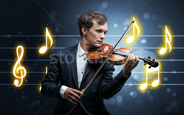 Young fiddler with music sheet Stock photo © ra2studio