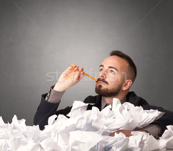 Businessman behind crumpled paper Stock photo © ra2studio