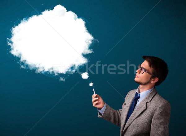 молодым человеком курение нездоровый сигарету плотный дым Сток-фото © ra2studio