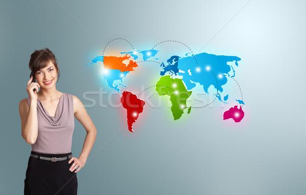 Jonge vrouw telefoongesprek kleurrijk wereldkaart mooie Stockfoto © ra2studio