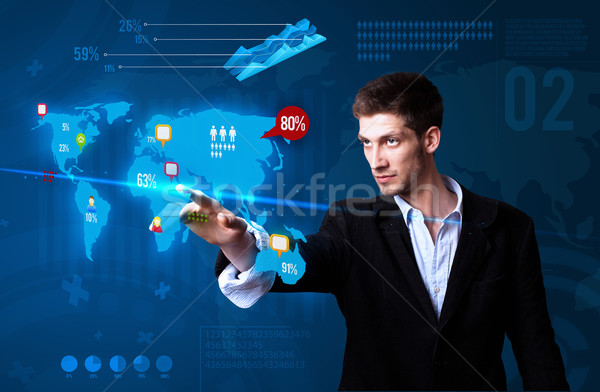 Businessman pressing social media button on the map Stock photo © ra2studio