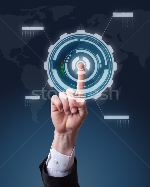 hand pushing a button on a touch screen futuristic interface Stock photo © ra2studio