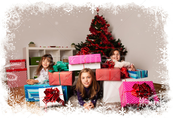 Kids with their christmas presents Stock photo © ra2studio