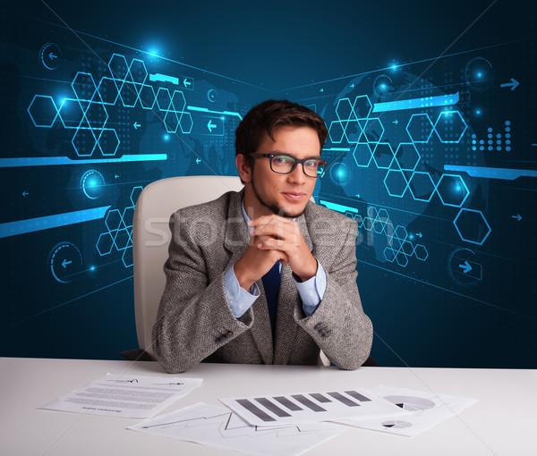 Businessman doing paperwork with futuristic backgroung Stock photo © ra2studio