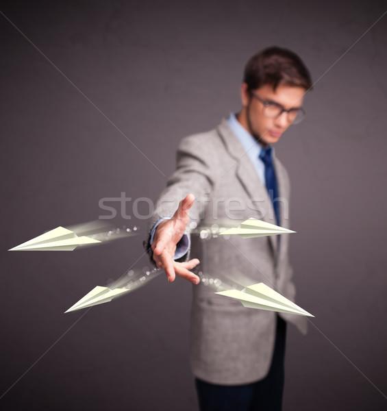 Jóképű férfi dob origami repülőgépek jóképű fiatalember Stock fotó © ra2studio
