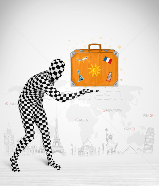man in full body suit presenting vacation suitcase Stock photo © ra2studio
