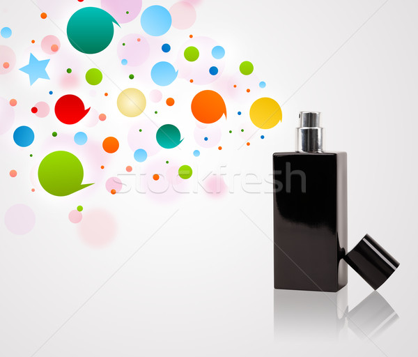 Perfume bottle spraying colored bubbles Stock photo © ra2studio