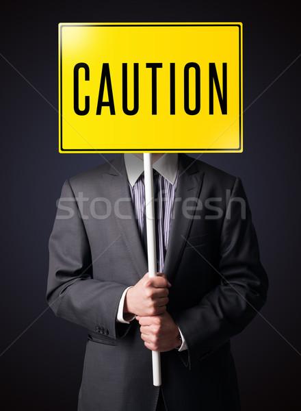 Stockfoto: Zakenman · voorzichtigheid · teken · permanente · Geel