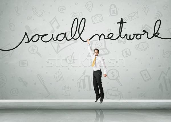 Opknoping zakenman touw hand ruimte Stockfoto © ra2studio