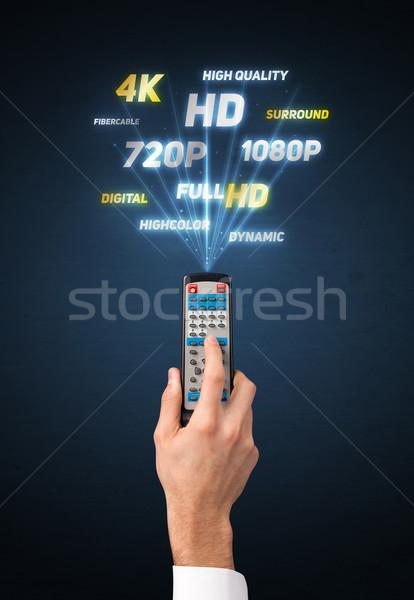 Hand Fernbedienung Multimedia halten heraus Technologie Stock foto © ra2studio
