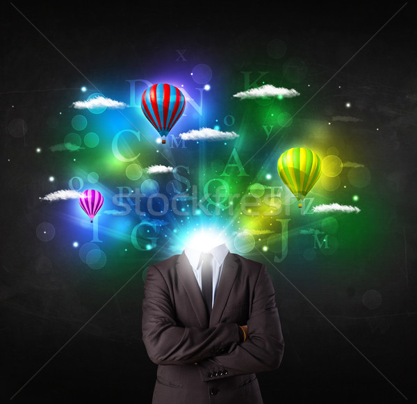 Man in suit with dreamy cloudscape concept Stock photo © ra2studio
