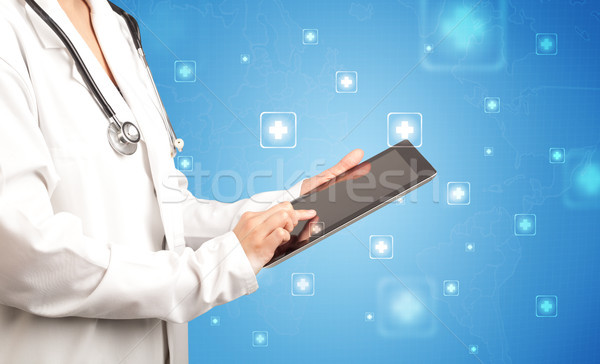 Female doctor with tablet Stock photo © ra2studio