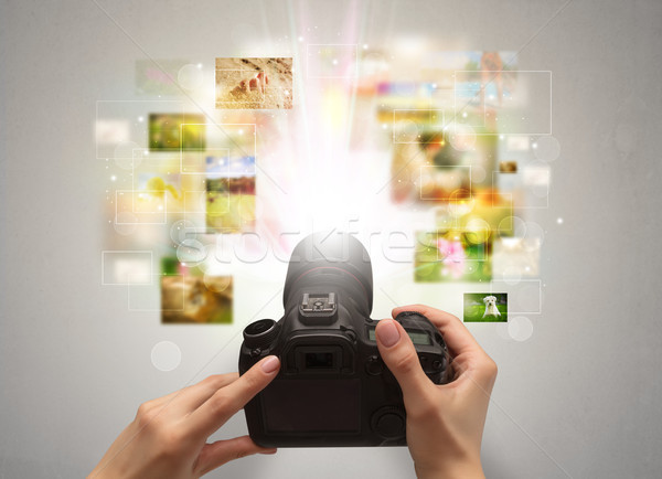 Hand captures life events with digital camera Stock photo © ra2studio