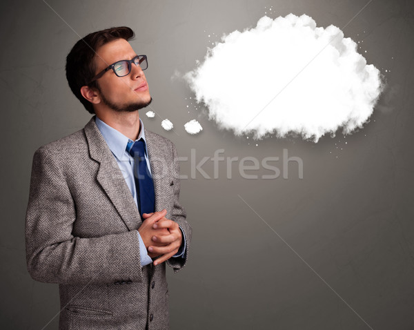 Stock photo: Good-looking young man thinking about cloud speech or thought bubble