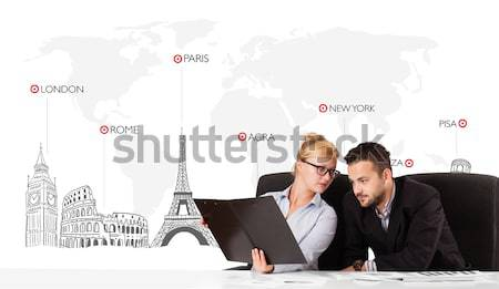 Stock photo: Young businessman and businesswoman with world map and major landmarks of the world
