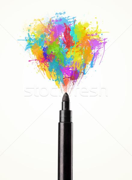 Felt pen close-up with colored paint splashes Stock photo © ra2studio