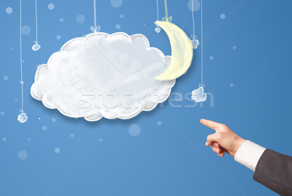Hand pointing at cartoon night clouds with moon  Stock photo © ra2studio