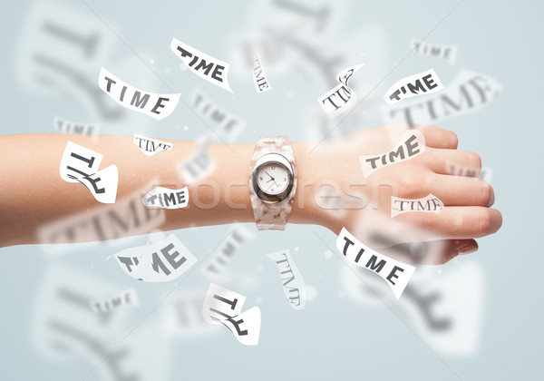 Clock and watch concept with time flying away Stock photo © ra2studio