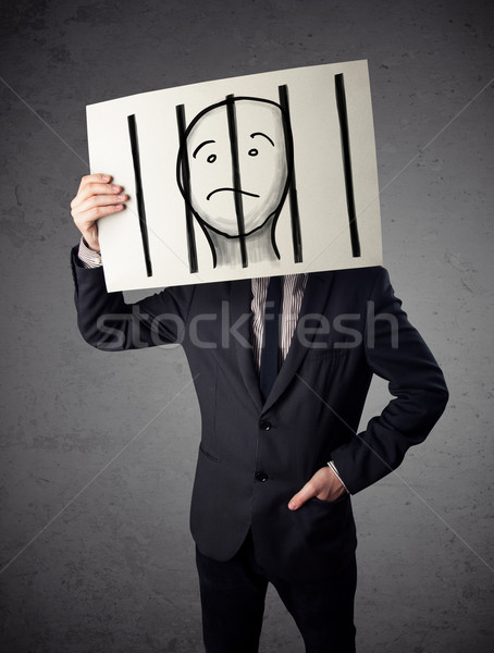 Businessman holding a paper with a prisoner behind the bars on i Stock photo © ra2studio