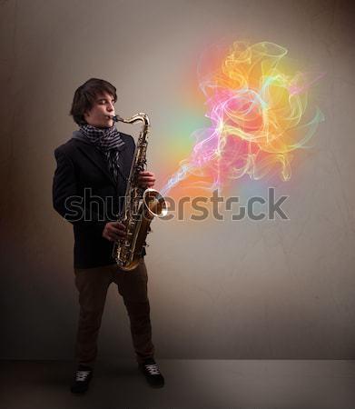 Aantrekkelijk muzikant spelen saxofoon kleurrijk abstract Stockfoto © ra2studio