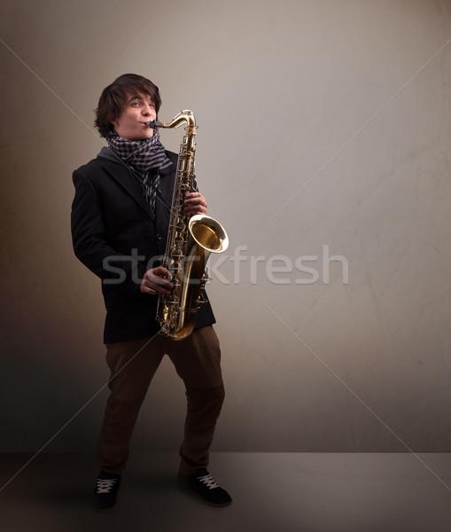 Jóvenes músico jugando saxófono guapo música Foto stock © ra2studio