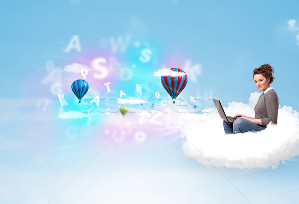 Young woman sitting in cloud with laptop Stock photo © ra2studio