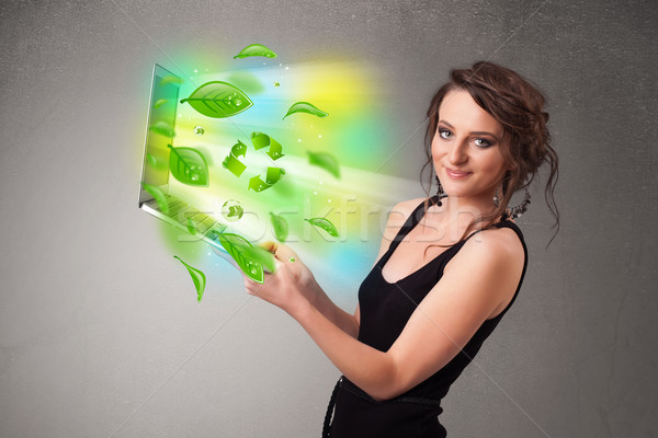 Casual woman holding notebook with recycle and environmental sym Stock photo © ra2studio