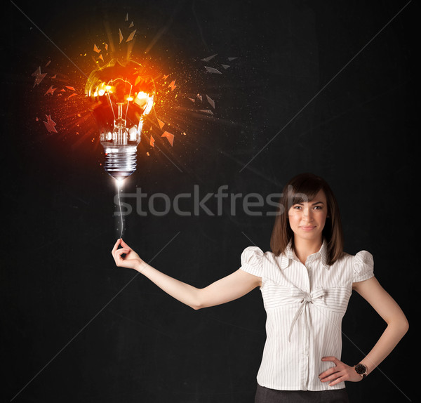 Femme d'affaires explosion ampoule noir affaires fille Photo stock © ra2studio